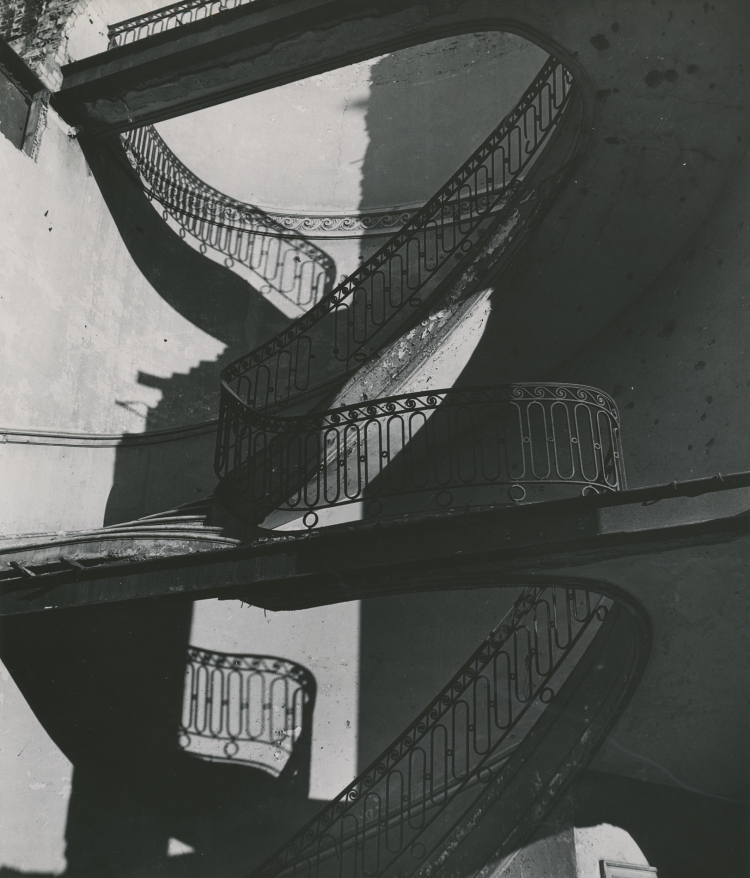 Bombed Regency Staircase, Upper Brook Street, Mayfair, 1942 © Bill Brandt Archives. Courtesy of Michael Hoppen Gallery